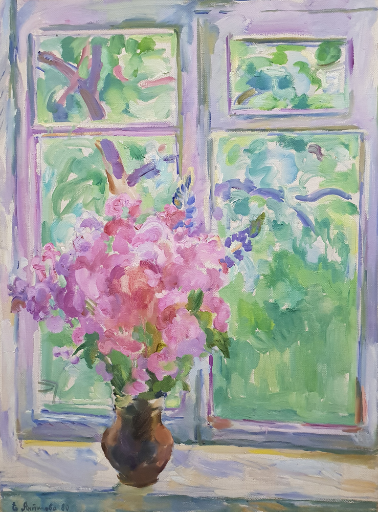 Lilac flowers on the window